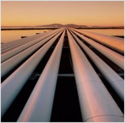 Oil pipelines vectoring to horizon against a light orange sky