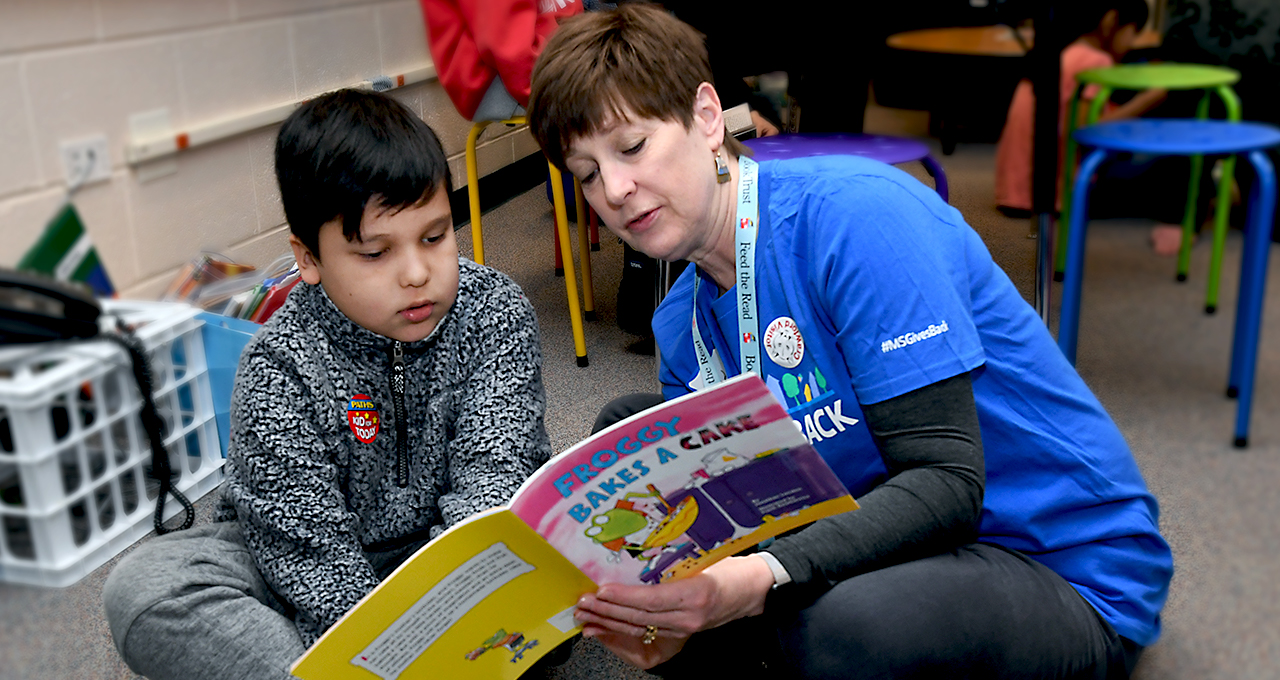 Morgan Stanley volunteer reading to child