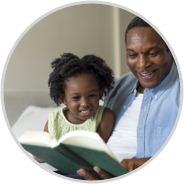 parent reading donated book with child