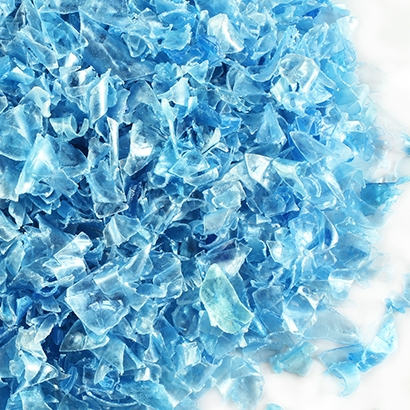 Pile of crumpled plastic bottles in a blue color tone